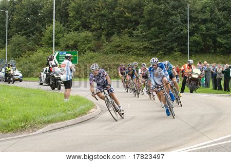 TELFORD, UK - SEPTEMBER 10: Tour of Britain Cycle Race - Lead Pack of Nine Riders with Chase Crew During Stage 4, Newport, Telford, September 10, 2008