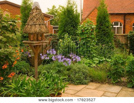 Quaint English Cottage Garden With Chapel In the Background