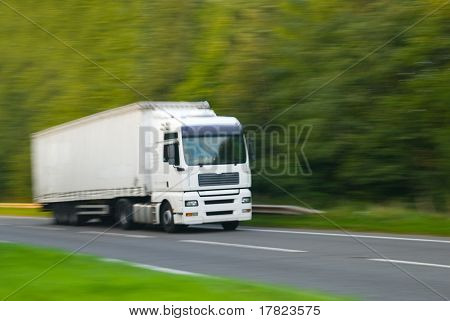Large plain white truck with motion blur (in camera effect)