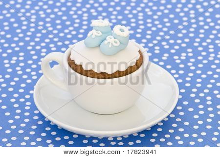 Christening cupcake with blue booties for a boy