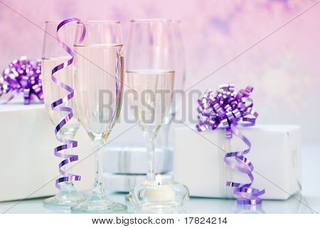 Champagne & gifts with purple bows and setting