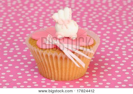 Christening themed cake on pink spotty background
