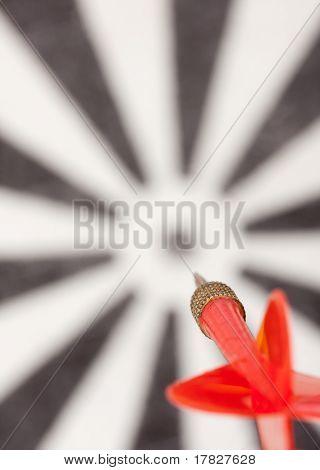 Red Flying Dart To Dartboard