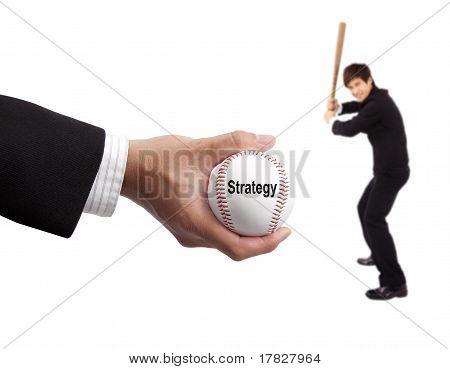 Concepto de estrategia de negocio. mano del empresario béisbol y delantero