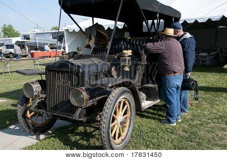 White Motorcar Needs Repairing