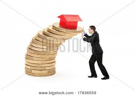 Business person trying to stop the real estate prices from falling