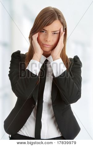 Young woman suffering a headache isolated on white background