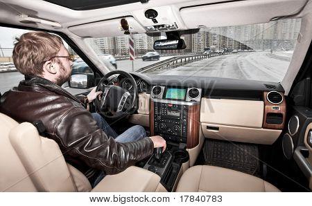 man at the wheel the car