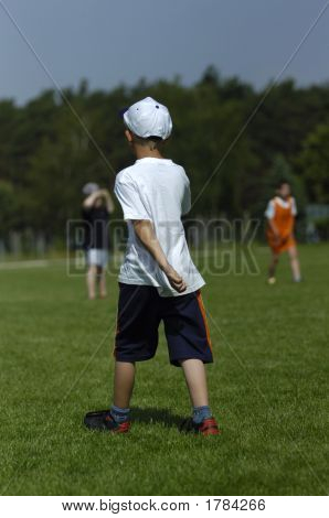 Little Boy Plays Soccer