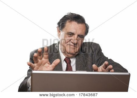 Senior Businessman With Laptop Gesturing With Hands