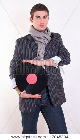 A Dj With A Vinil Disc In His Hands