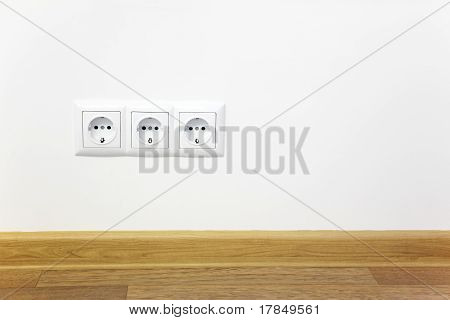 Empty Interior  White Wall  With Power Outlet
