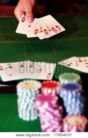 Poker Player Showing Unbeatable Royal Flush