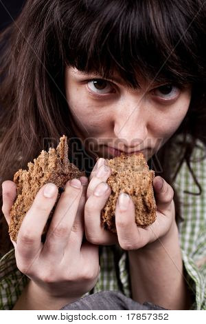 Beggar Woman With A Piece Of Bread In Her Hands
