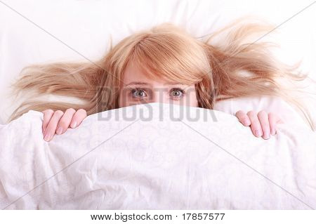 Young Beautiful Afraid Woman In Bed