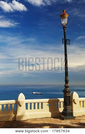 Street lamp in front of the sea, Algiers, Algeria