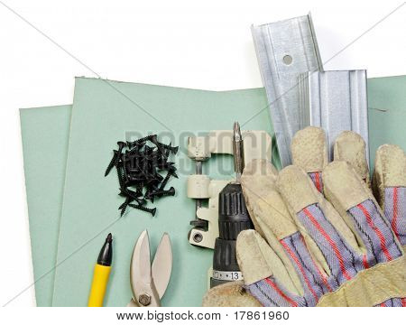 Plasterboard tools set with metal studs, screws, screwgun, punch lock crimper, tin snip cutter and protective gloves on white background
