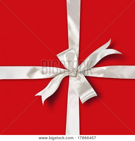 White satin ribbon over red paper gift box