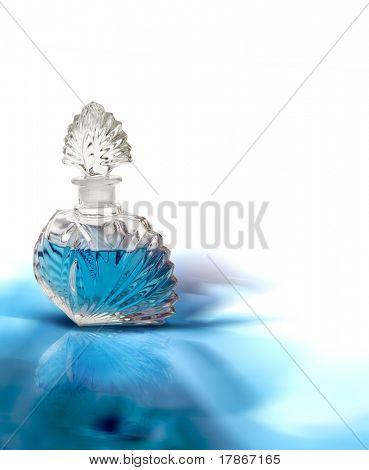 Vintage perfume bottle on a blue background