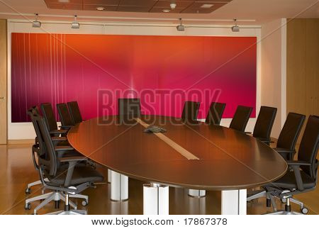 Modern meeting room with a big red painting
