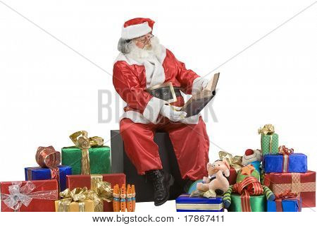 A real Santa Claus portrait checking his list