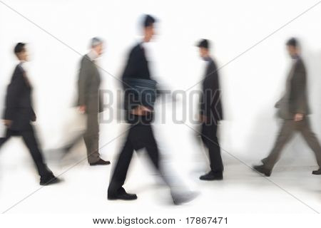 Business people walking, motion blurred