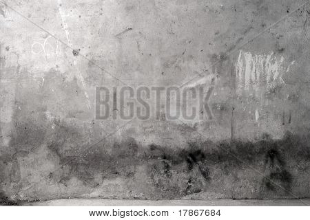 Grey grunge cement wall with some scribbles