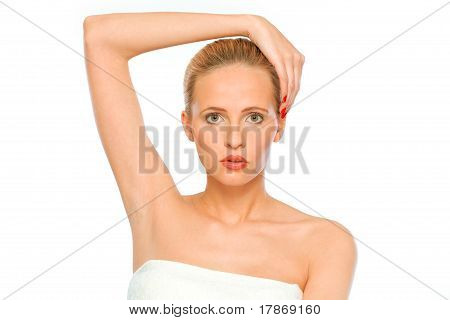 Portrait of fresh beautiful woman with hand on head isolated on white