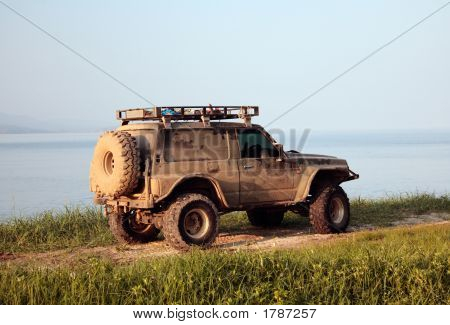 Jeep Upgraded For Off-Road On Shore Pacific Ocean In Sunset Rays