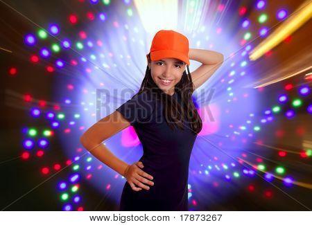 Beautiful Latin teen hispanic girl orange cap posing dancing disco lights
