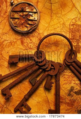 Bunch of keys with a gears on the old textured paper
