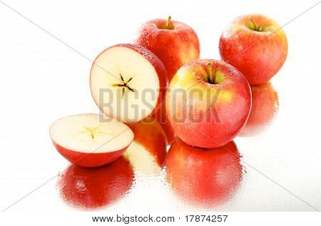 Group of wet apples, mirror