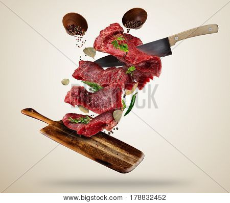 Flying pieces of raw steaks
