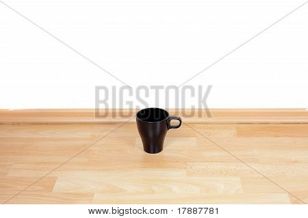 Cup Standing On The Floor In The Room
