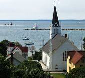 Peaceful Bay With Church And Lighthouse
