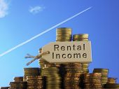 Blue sky with jet going upward as background and  stacks of coin with tag written rental income poster