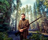 Hunter in vintage hunting clothing with old gun poster