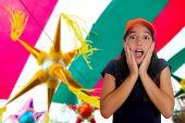 foto of pinata  - Beautiful Latin teen hispanic girl cap surprise gesture pinata party celebration - JPG
