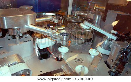 DVD replicator robotic arms in morion