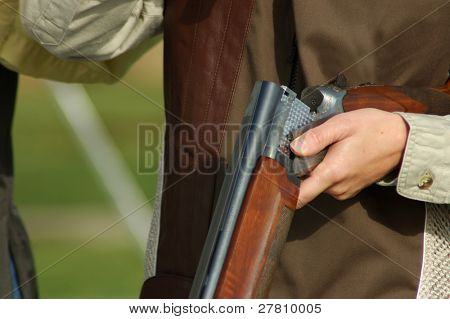 woman with open shotgun on a trap range