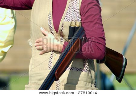 woman with shotgun on trap range