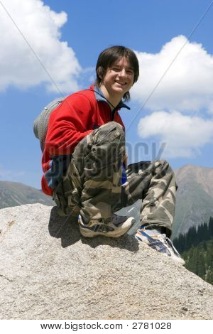 Teenager In Red Sport Pullover In Mountain