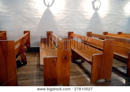 Pews of Mission San Miguel, Sante FeNM. Erected 1610 it is the oldest house in the US