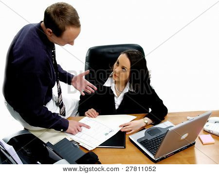 Businessman and businesswoman conducting an executive business meeting