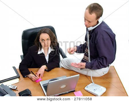 Businessman and businesswoman making a credit card purchase by phone