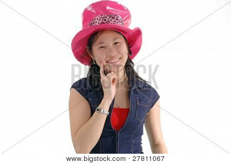 Young Asian woman in a silly pink hat