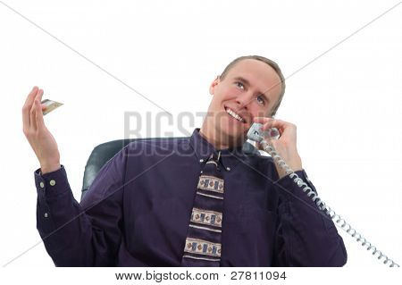 Businessman making a credit card purchase by phone