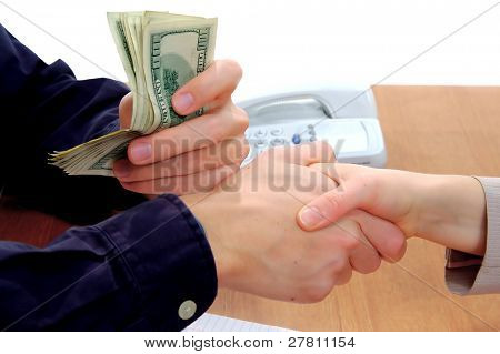 Business deal paid and sealed with a handshake
