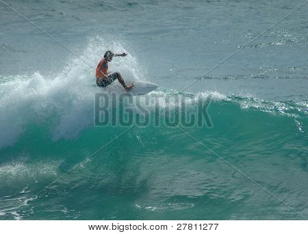 Surfer cutting back across the crest of the wave