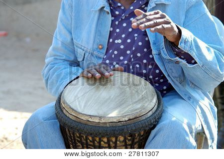 Close up look at the hands of a street performing drummer